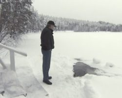 """Lucky Elderly Man Is Greeted Every Day By """"A Friend"""" Who Crawls Out Of The Ice"""