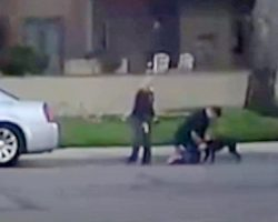 Woman Shoots Dog In Broad Daylight While Man Holds Him Down In Middle Of Road