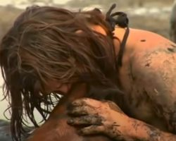 Woman Holds Up The Head Of Her Horse Who Was Sinking Further Into The Mud